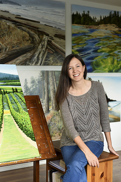 Don Denton/Boulevard October 18, 2019 - Artist Kelly Corbett in her Nanoose Bay studio with some of her paintings.